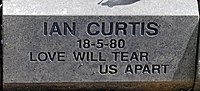 Joy division-Ian_Curtis_post-2008_memorial_stone_at_Macclesfield_Cemetery.jpg